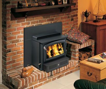 Regency H2100 Wood Fireplace Insert and Hearth Warmer on brick hearth