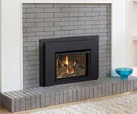 Regency L234 Traditional Gas Fireplace Insert in black with gray brick surround