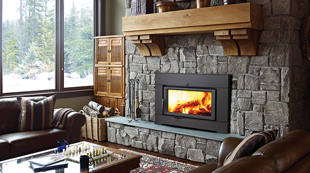 Regency Ci2600 Wood Fireplace Insert with dark stone surround and hearth in living room