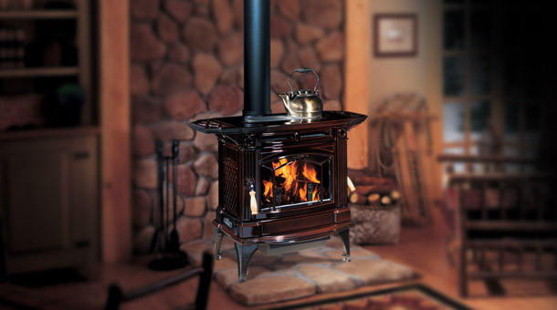 Regency H300 Hampton Cast Iron Free Standing Wood Stove Fireplace in brown with tea kettle on top