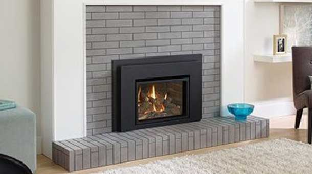 Regency L234 Gas Fireplace Insert with gray brick surround