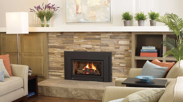 Regency U32 Gas Fireplace Insert with beige stone surround