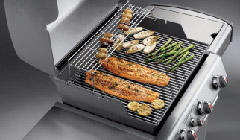 salmon, asparagus, and other vegetables on a weber grill