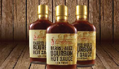 barrel-aged bourbon hot sauce three bottle display